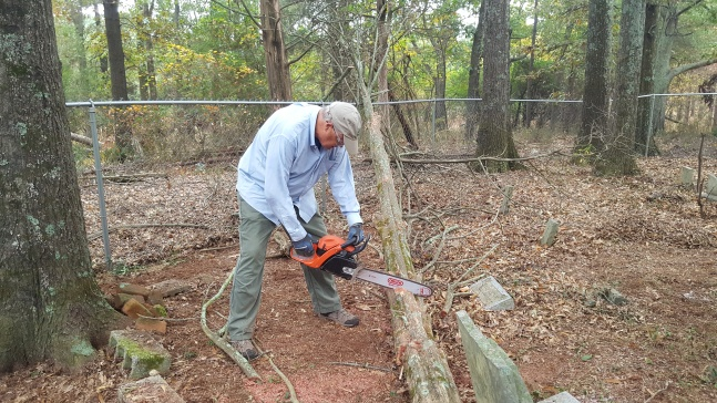 Eric Roberts chainsawing at Roberts Family Cemetery, November 2016